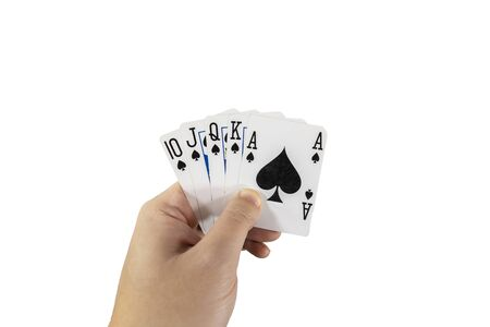 POV view of a man holding playing cards in his hands isolated on white background. Gambling concept. Foto de archivo