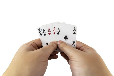 POV view of a man holding playing cards in his hands isolated on white background. Gambling concept. 写真素材