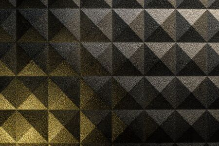 Pyramid pattern background with a rough surface and contrasting light