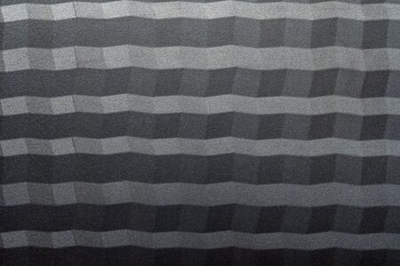 Geometric pattern background with a rough surface and contrasting light