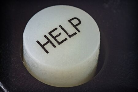 Extreme macro of a help button on a TV remote control Stock Photo