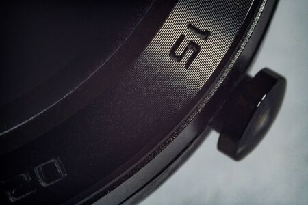 Extreme macro shot of a metal smartmatch with numbers on the side Stock Photo