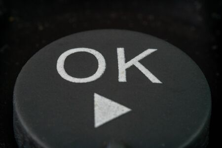 Extreme macro shot of an ok button on a remote control for a TV Stock Photo
