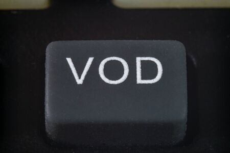 Extreme macro of a video on demand button on a TV remote Stock Photo