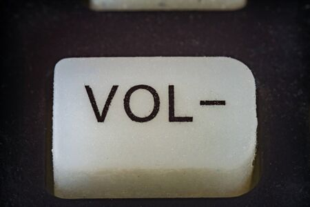 Extreme macro shot of volume button on a TV remote