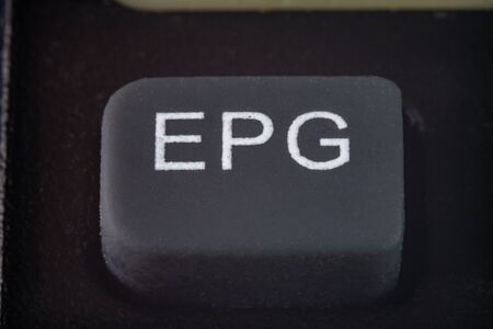 Extreme macro of a electronic programming guide button on a TV remote Stock Photo