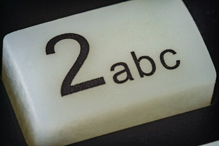Extreme macro of number 2 button with letters