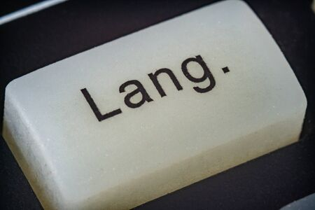 Extreme macro of a language button on a TV remote