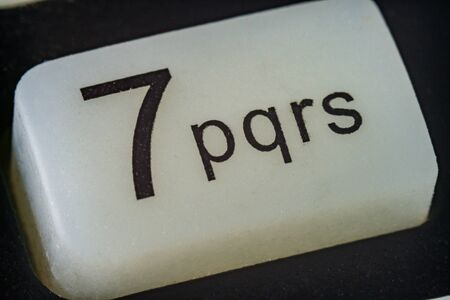 Extreme macro of number 7 button with letters Stock Photo