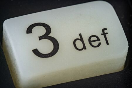 Extreme macro of number 3 button with letters