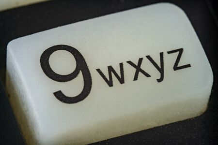 Extreme macro of number 9 button with letters