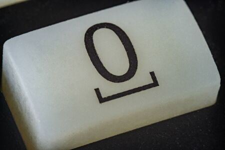 Extreme macro of number 0 button with letters