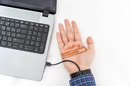 Augmented human hand connected to a laptop via usb cable and transferring data with hologram notification