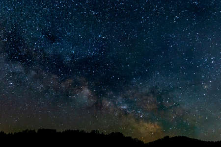 PAnoramic view of the Milky way over a mauntain range