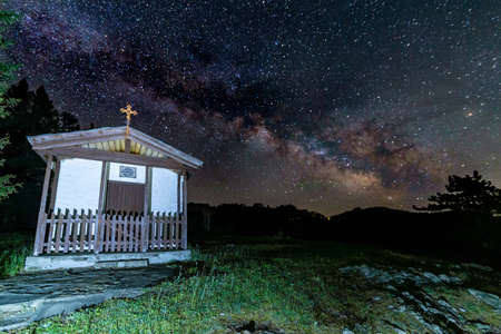 Chapel St. Peter and Paul near Momchilovtsi village in Bulgaria with the Milky way in the background