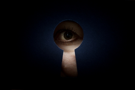 female eye in the keyhole