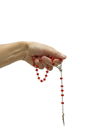rosary in his hand on a white background photo