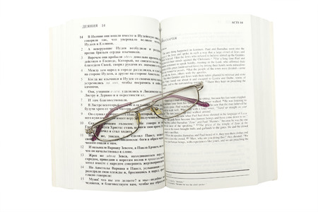 hebrews: Opened Bible and wire-rimmed glasses