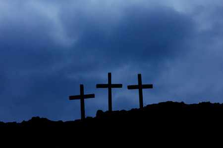 golgotha: three crosses on Golgotha ​​among the clouds