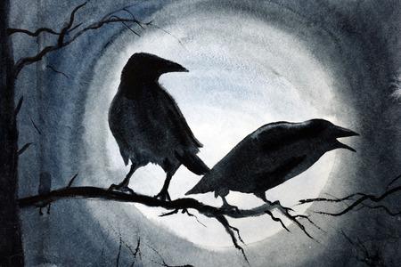 twee zwarte kraaien op een boomtak Stockfoto