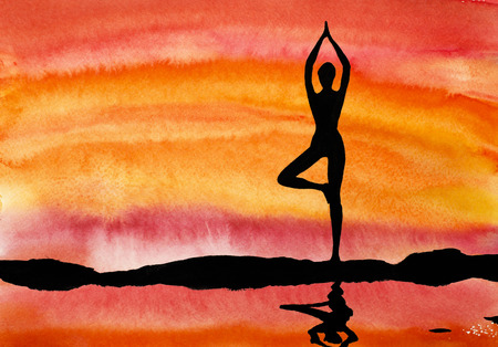 yoga at sunset on a background of water photo