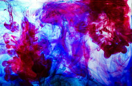 purple abstract: red blue and purple inks in water Stock Photo