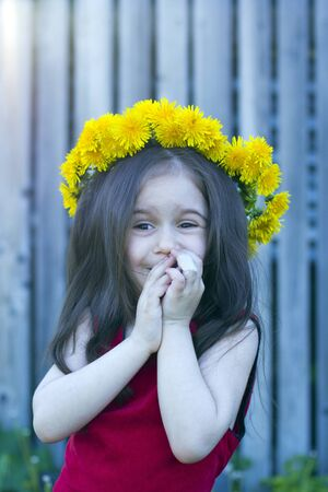 happy little girl in floral wreath photo