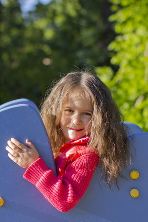 wistful: tender and wistful smile on the face of a little girl Stock Photo