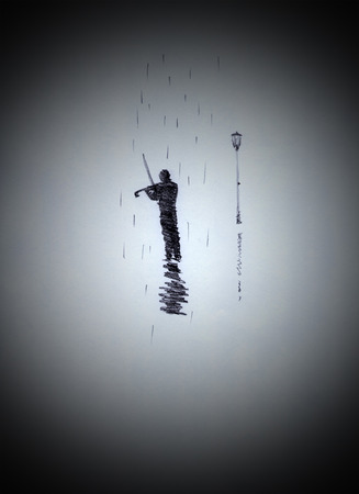 fiddles: Fiddler on the street in the rain Stock Photo