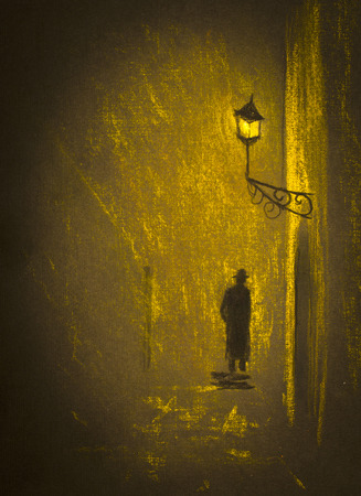 dark city: a man in a hat and coat under the lamp