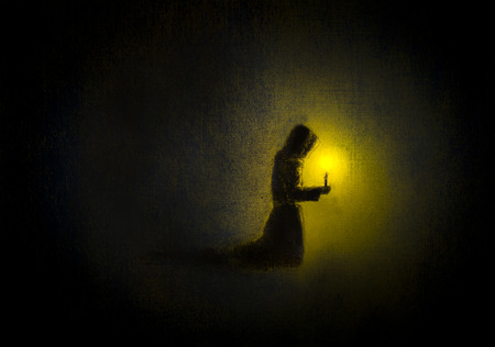 monk praying with a candle