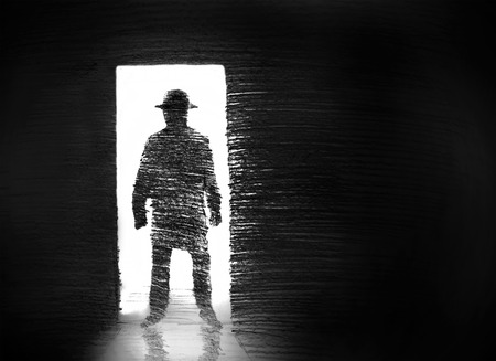 inside of: man in the doorway wearing a hat