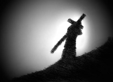 夕暮れ時に肩に十字架を運ぶ男