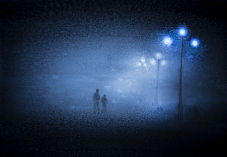 fog: Two people in the light of the street lamps
