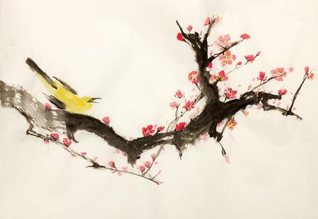 밝은 벚꽃 나뭇 가지와 노란색 조류