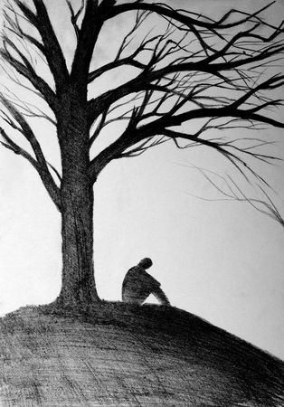 sitting meditation: silhouette of a man sitting under a tree Stock Photo