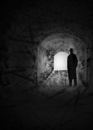 man standing alone: man in a hat and coat in a dark doorway