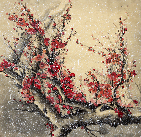 Flowering plum branch and snowy winter