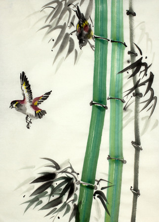 bamboo and birds in flight Stock Photo