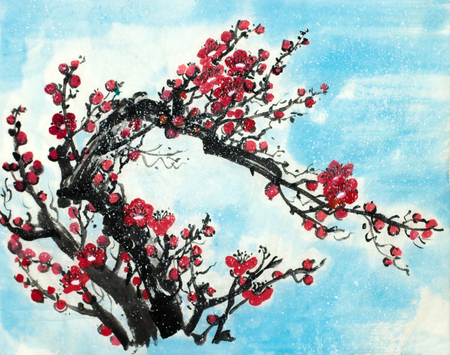 plum branch under the snow on a blue background 스톡 콘텐츠