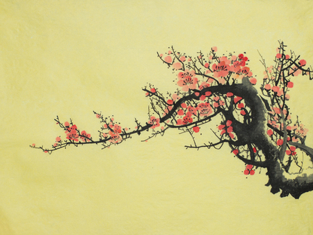 flowering plum branch on a yellow background