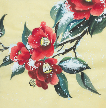 red camellia flower under the snow