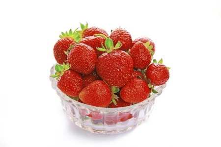 Strawberries in a bowl on a white background. Stock Photo