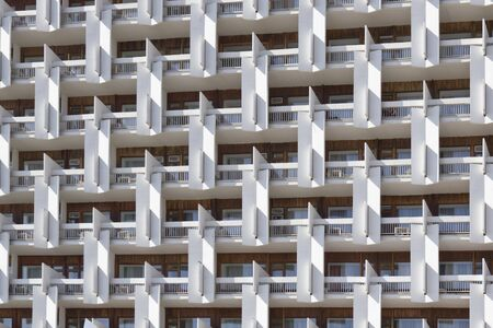 The facade of a multi-storey buildings photographed on a sunny day  Stock Photo