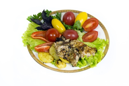 Roasted chicken breast with tomatoes, peppers and lettuce in a bowl. Stock Photo