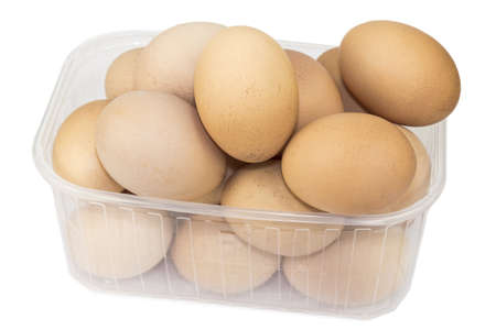 Eggs in a plastic container on a white background, close-up shot.