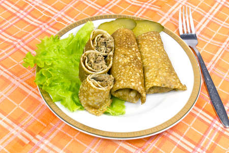 Stuffed fried pancakes with meat, lettuce and cucumbers