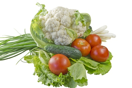Fresh vegetables - lettuce, cucumber, tomato and onion on a white background  Stock Photo