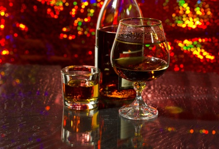 A bottle of brandy and a glass  Stock Photo
