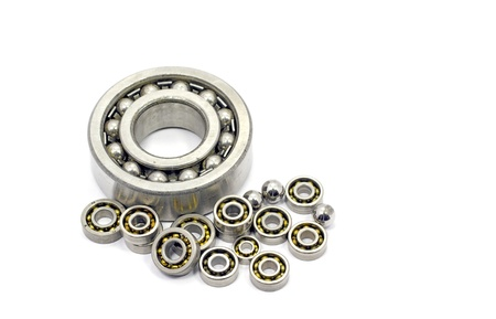 Roller bearings of different sizes on a white background